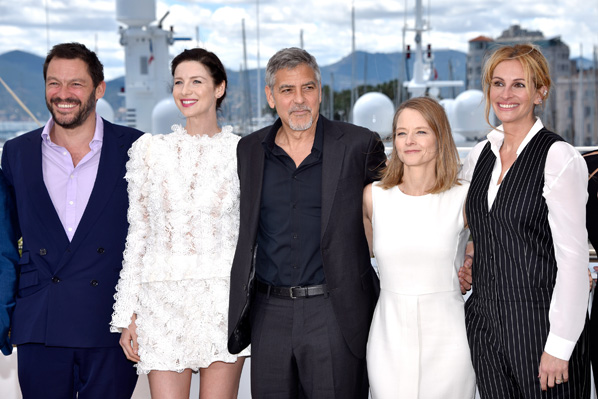 """CANNES, FRANCE - MAY 12:  (L-R) Dominic West, Caitriona Balfe, George Clooney, director Jodie Foster and Julia Roberts attend the """"Money Monster"""" photocall during the 69th annual Cannes Film Festival at the Palais des Festivals on May 12, 2016 in Cannes, France.  (Photo by Clemens Bilan/Getty Images)"""