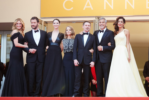 CANNES, FRANCE - MAY 12, 2016: Money Monster's Hollywood heavyweights steal the spotlight with the most talked about fillm at Cannes.  Actors Julia Roberts, Dominic West, Caitriona Balfe, director Jodie Foster, actors Jack O'Connell, George Clooney and his wife Amal Clooney attend the 'Money Monster' premiere during the 69th annual Cannes Film Festival at the Palais des Festivals.(Photo by Kristina Nikishina/Epsilon/Getty Images)